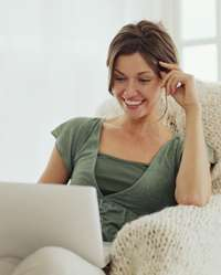 Woman reading newsletter on laptop
